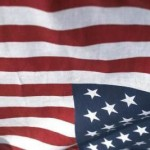 U.S. Flag upside down is a signal of distress; as per THE FLAG CODE Title 36, U.S.C., Chapter 10 As amended by P.L. 344, 94th Congress Approved July 7, 1976